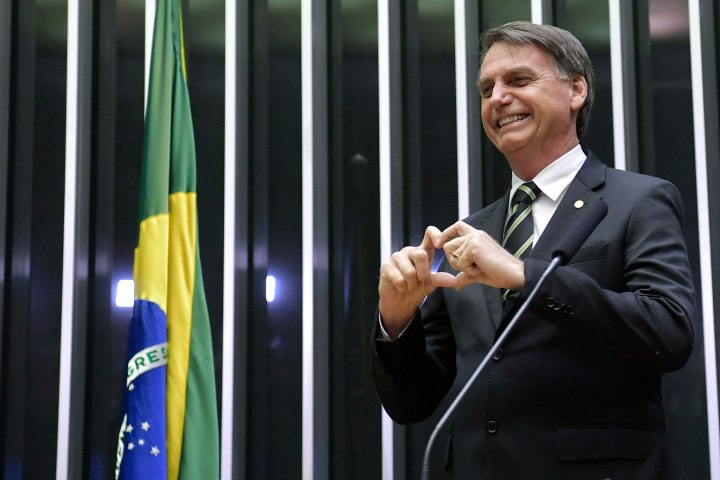 Jair Bolsonaro, President-elect of Brazil, making the heart sign with his hands