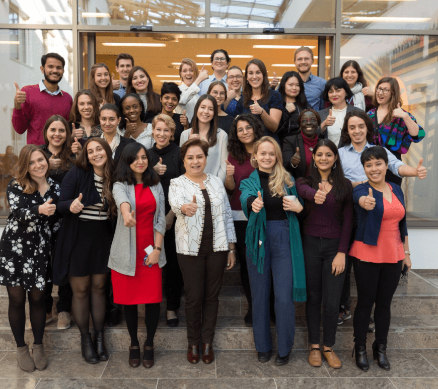 A group photo of Patricia Espinosa, Executive Secretary of UN Climate Change, meeting with interns at the UNFCCC.