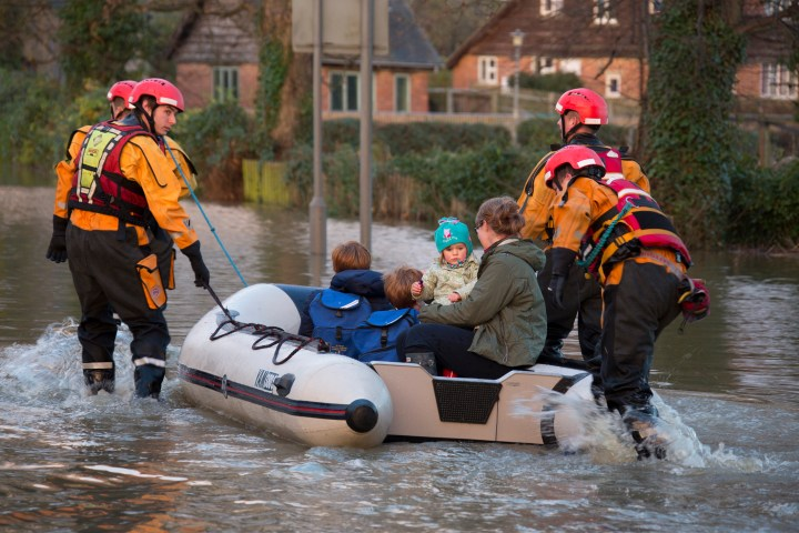 Young family being rescued by the fire service after the River Derwent burst it's banks in the village of Old Malton in North Yorkshire in northeast England.