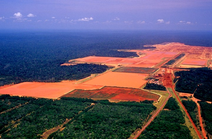 Amazon seen from above with large swathes that have been cleared and are covered in industry