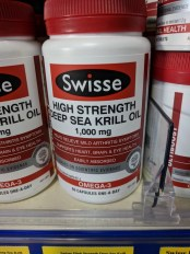 Vitamin tablets with a label saying 'high strength deep sea krill oil'