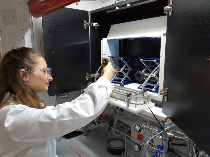 A picture of PhD student Megan Taylor using the Air Pollution Simulation Chamber