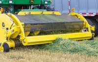 Forage harvester picking up the swath