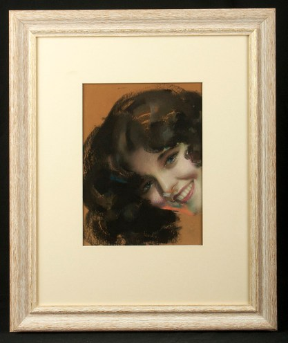 Framed and matted behind glass in gold toned bleached wood frame