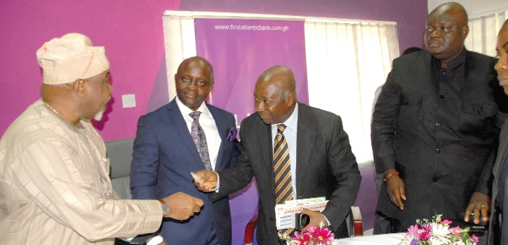 Nana Owusu Afari (2nd right) interacting with Mr Olusheyi Onafowokpom Ademola (left) Nigeria High Commissioner in Ghana, after the media launch in Accra.