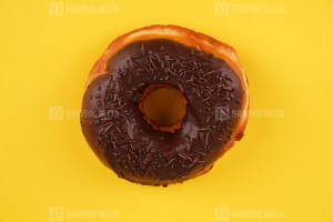 Donut isolated on yellow background