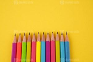 Pencils on Yellow Stock Photo