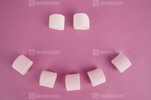 Emoji from sweet marshmallow on purple background