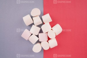 Fluffy marshmallow on colorful background stock photo