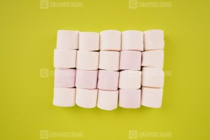 White marshmallow on green background