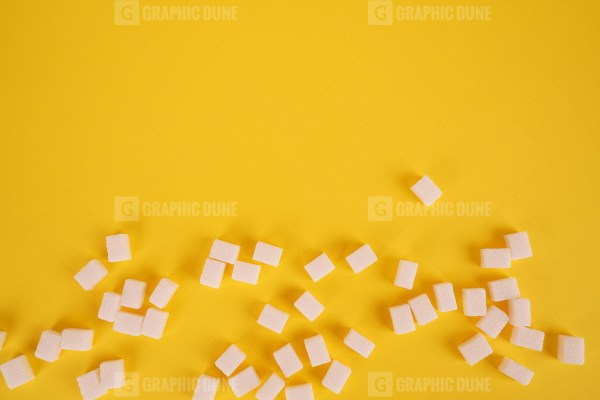 Lump sugar on yellow stock photo