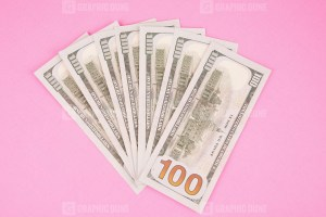 Seven Hundred Dollars Isolated on Pink