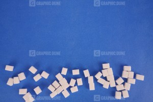 Sugar cubes on navy background stock photo