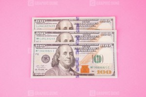US Hundred Dollars Isolated on Pink