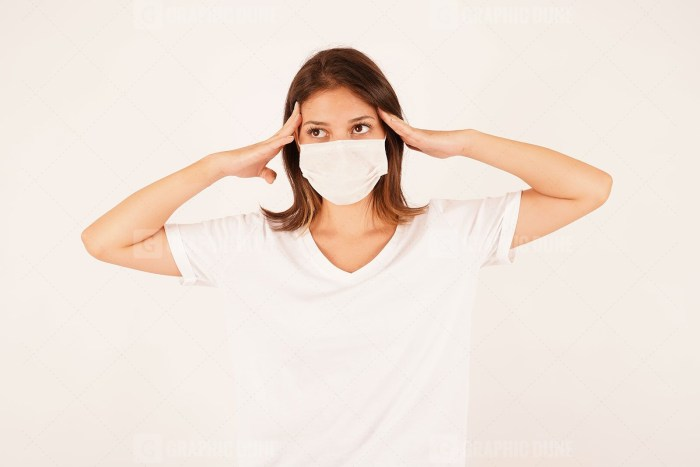 Anxious woman wearing medical mask