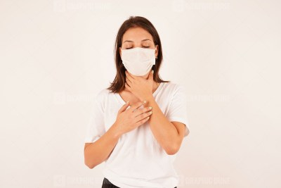 Girl in medical mask touching neck