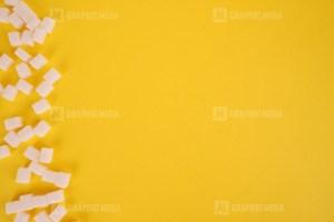 Cube sugar on yellow background stock photo