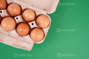 Eggs in the package on green