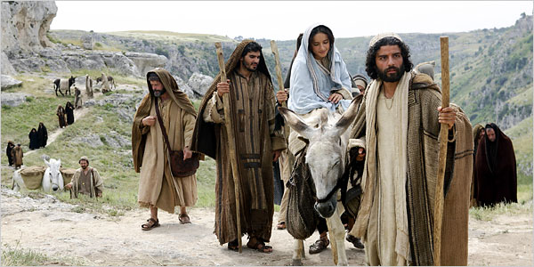 Mary and Joseph on their way to Bethlehem; a still-shot from the movie The Nativity Story.  Click the image for great articles about the movie at DecentFilms.com.