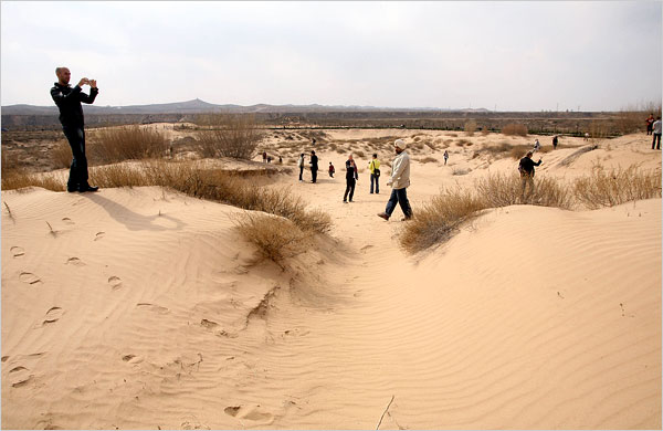 THE SURVEY Design teams explore the site for the villas of Ordos. Photo Doug Kanter for The New York Times