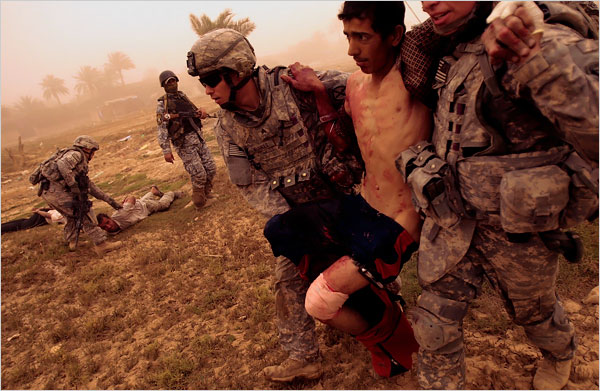 Soldiers from the 2nd Battalion, 30th Infantry Regiment of the 10th Mountain Division carried a wounded Iraqi man to be evacuated to a military hospital after he was shot when he tried to run from their platoon during a routine morning patrol. The patrol encountered three men digging in an area of frequent insurgent activity, and the man ran and was shot in the leg. He was treated by an American medic traveling with the platoon, and then transported to a military base for medical care. The other two men were arrested and released.