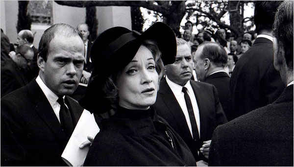 "The Lost Manuscript,"" accompanying a photo of Marlene Dietrich at Gary Cooper's funeral in 1961."