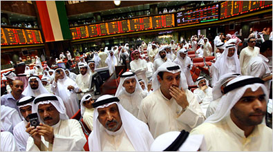 Traders at the Kuwait stock exchange, where shares have fallen 19 percent this year and trading was halted on a troubled bank.
