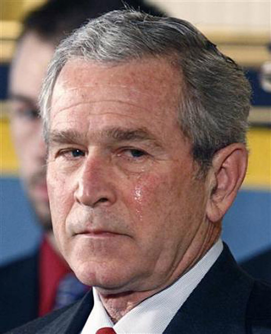 Tears run from the eyes of President George W. Bush during a ceremony in honor of Medal of Honor winner Marine Cpl. Jason Dunham in the East room of the White House in Washington, January 11, 2007. Cpl. Dunham was killed when he jumped on a grenade to save fellow members of his Marine patrol while serving in Iraq. REUTERS/Jim Bourg