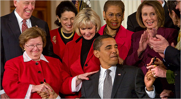 President Obama signed his first bill into law on Thursday, approving the Lilly Ledbetter Fair Pay Act, a law named for Ms. Ledbetter, fourth from left, an Alabama woman who at the end of a 19-year career as a supervisor in a tire factory complained that she had been paid less than men.
