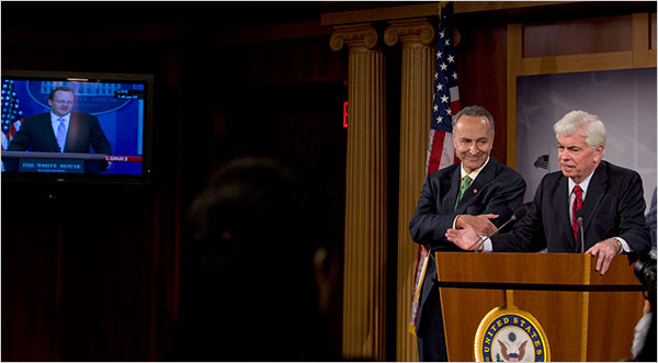 Senators Charles E. Schumer, left, and Christopher J. Dodd spoke to reporters on Tuesday after the Senate voted to put new restrictions on the credit card industry.