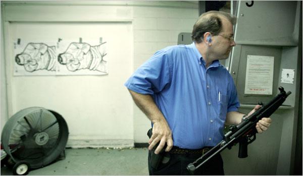 Ken Pagano, the pastor at New Bethel Church, prepared to try a Heckler & Koch MP5 submachine gun at a shooting range.
