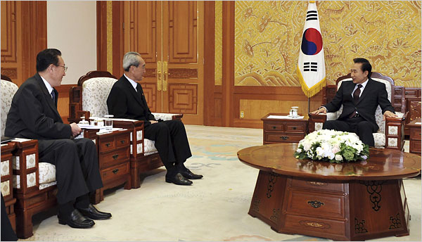 Lee Myung-bak Meets with DPRK Envoys in Seoul today (image courtesy Reuters, via NYT)