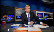 Lou Dobbs at the anchor desk at CNN's New York studio in 2006.