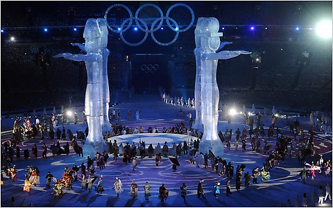 Dancers perform around four totems during the Opening Ceremony.