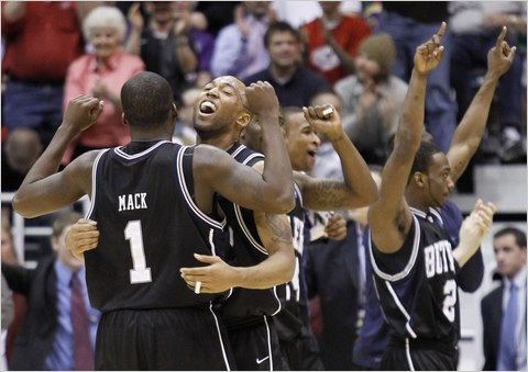 Butler forward Willie Veasley celebrates with guard Shelvin Mack (1) and teammates after defeating Syracuse.