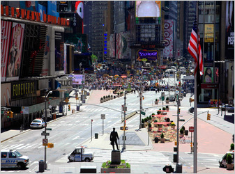Authorities cleared streets around New York's Times Square and called in the bomb squad Friday, after finding a suspicious item.