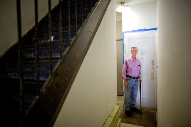 "Mr. Burke says he has spent $13,500 on repairs and $11,000 taking his landlords to court over the conditions. ""It's been hell,"" he said. ""Now you see, it's no bargain."" (Photo by Robert Caplin for The New York Times)"
