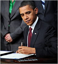 President Obama signing the bill.