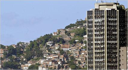 An apartment building in front of the Rocinha shantytown in Rio de Janeiro.