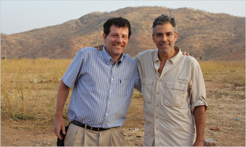 Nicholas Kristof and George Clooney in Chad in 2009.