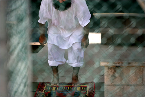 A detainee at the Guantánamo Bay prison prayed outside his cell in 2007, in an area for the most compliant detainees.