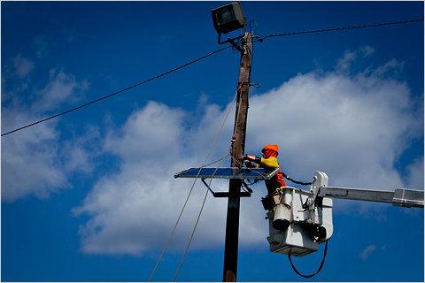A lineman installing solar panels in Totowa, N.J.