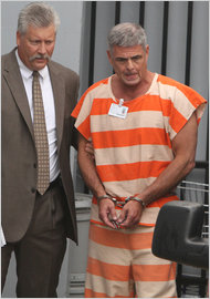 A federal agent escorted Lee B. Farkas, a former mortgage industry executive, after a court appearance in June 2010 in Ocala, Fla.