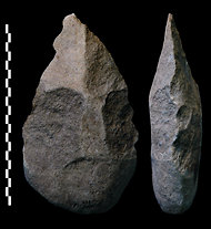 A study dates human tools like this ax to 1.76 million years ago.