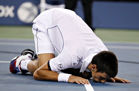 Novak Djokovic kissed the court after defeating Rafael Nadal to win the men's U.S. Open title on Monday.