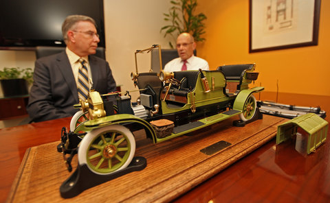 A model of the faux-vintage electric car that horse advocates say could replace carriage horses in New York, with Ed Sayres, left, and Steve Nislick of NY-CLASS, the group that sponsors the cars.