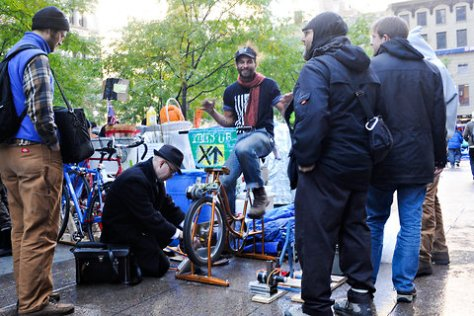 Keegan Stephan pedaled to charge a battery that would be used for the power needs of protesters at Zuccotti Park on Sunday.
