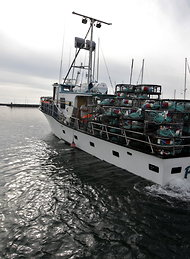A crab fishing boat preparing to set out in Half Moon, Calif., on Monday.
