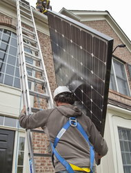 Installing solar panels on a home in Belmar, N.J.