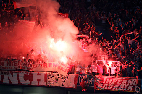 Bayern Munich fans light flares during the match.